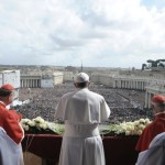 """Pope Francis speaks during his """"Urbi et Orbi"""" address from a balcony in St. Peter's Square at the Vatican"""