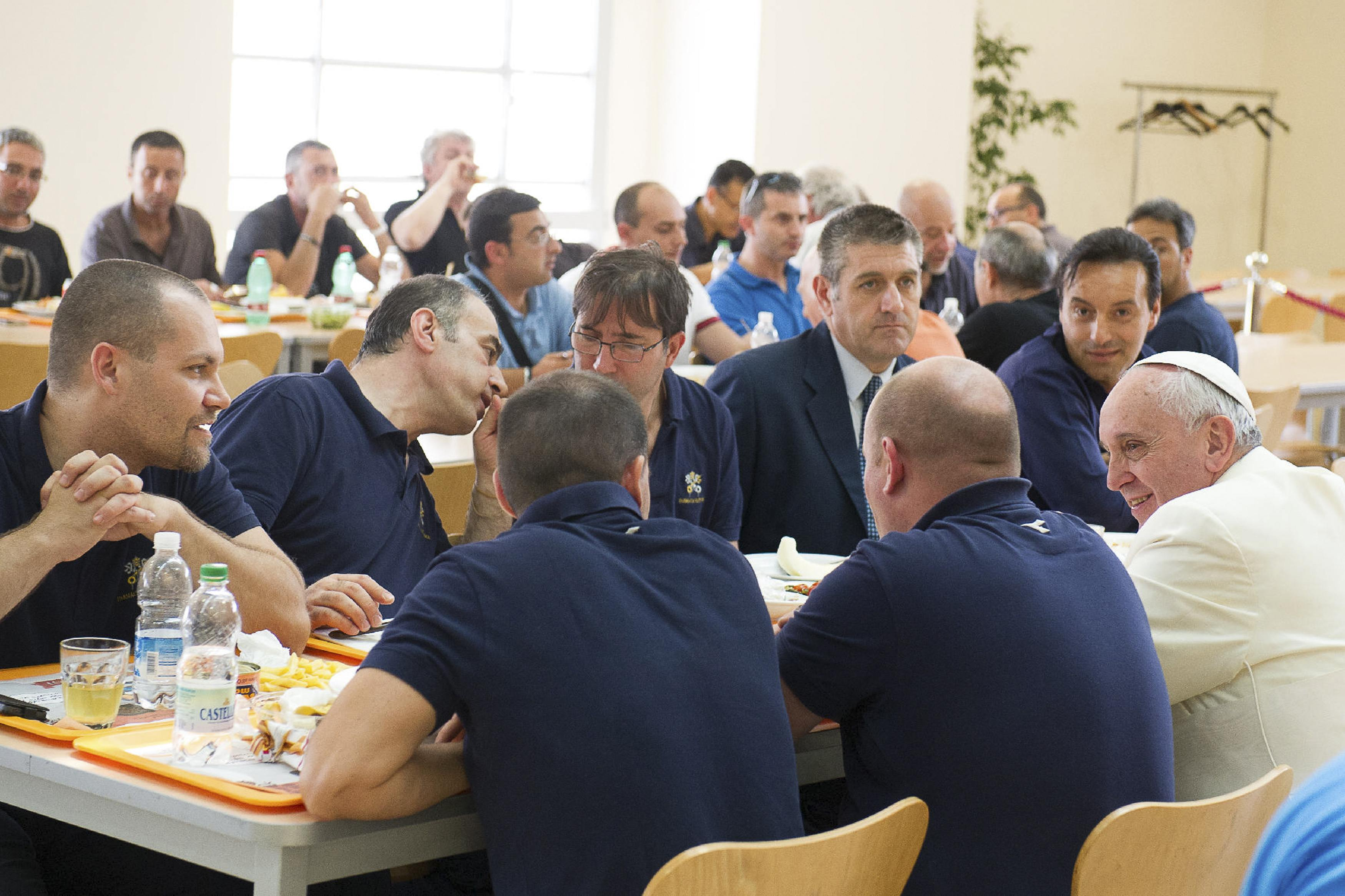 Pope Francis talks with Vatican workers during a surprise visit to the Vatican cafeteria July 25. (CNS photo/L'Osservatore Romano via Reuters) (July 25, 2014) See CAFETERIA-POPE July 25, 2014.
